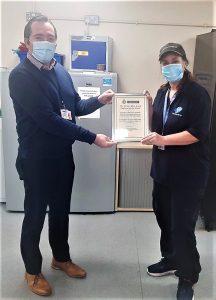Sharron receiving her award from Paul